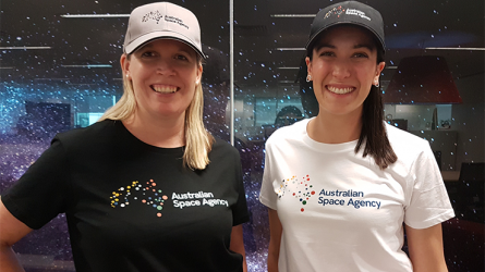 Photo of two women wearing Australian Space Agency t-shirt featuring the brand