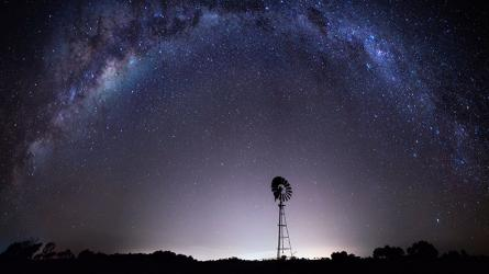 Purple night sky with stars showing the Milky Way from outback Australia.